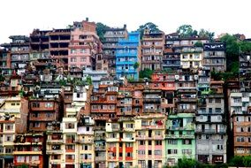 bright painted grunge apartments on hillside, nepal