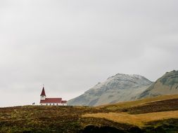 chapel building in rural mountain landscape, iceland