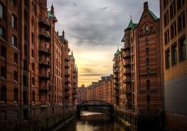 Speicherstadt, old red storehouses at river, Germany, Hamburg