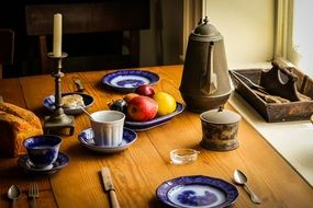 still life, vintage dishware and food on dinner table