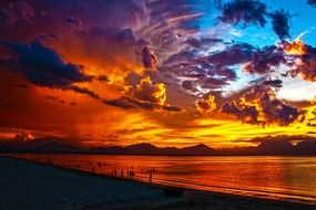 awesome sunset sky above lagoon and beach, vietnam, da nang bay