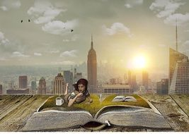 woman lying on open book at cityscape, collage