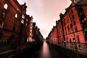 old red brick buildings in waterline at evening, germany, hamburg