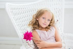 young blue eyes girl in white chair