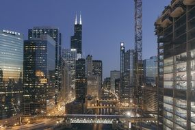 sears and willis towers in night cityscape, usa, illinois, chicago