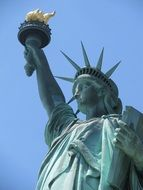 fragment of statue of liberty with torch, usa, manhattan, nyc