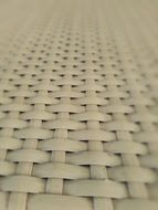 texture of weaved chair seat, white plastic
