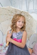 pretty child girl with white umbrella in studio, portrait