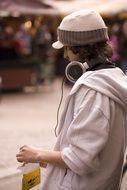 young man with headphones in city