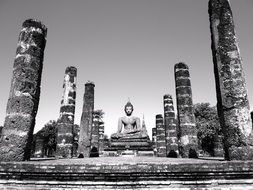 black and white image of statue sitting buddha