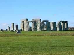 stonehenge on green grass at blue sky, uk, england