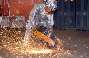 construction worker sawing metal
