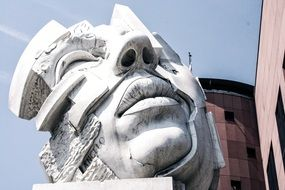 dead man's face at sky, modern stone sculpture, monument to soldier