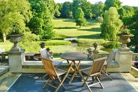 chairs and table on terrace of castle at park, germany, mecklenburg