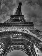 bottom view of eiffel tower at cloudy sky, france, paris