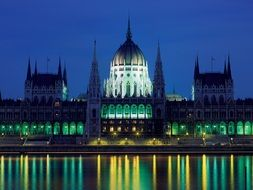 parliament building in colorful night lights at deep blue sky, hungary, budapest