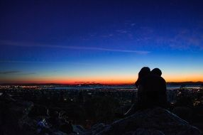 silhouette of kissing couple at dusk