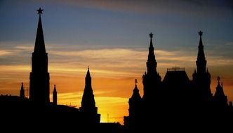 kremlin towers silhouettes at colorful evening sky, russia, moscow