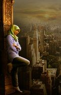 young muslim girl stands at cityscape