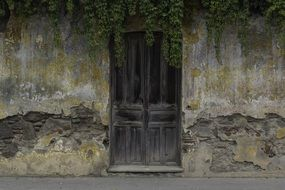ancient facade and wood door of old house in Guatemala in Central America