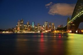 bridge and city on harbour at night, australia, milsons point