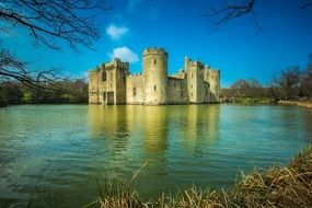 bodiam castle with mirroring on water at winter, uk, england