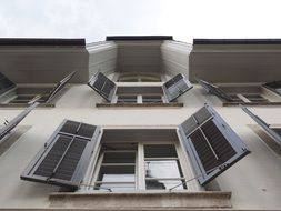 windows with open shutters on facade