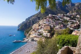 beautiful view of beach and town on amalfi coast, italy