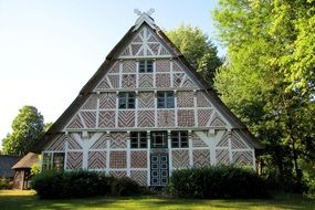 beautiful ornamented timber framed farmhouse at summer, germany