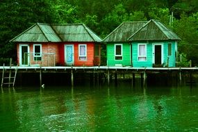 traditional houses on stilts on a tranquil lake