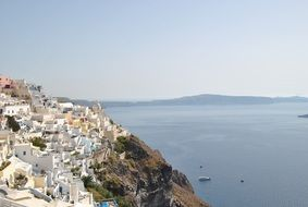 white town on mountain at sea, greece