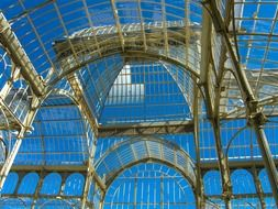 metal and glass ceiling at blue sky