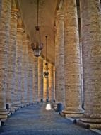 walkway through Bernini Colonnade surrounding St. Peter's Square, italy, rome