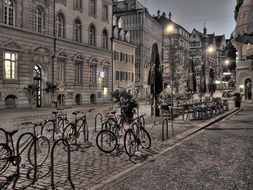 bicycles on parking at street cafe in old city, germany, freiburg
