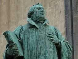 martin luther with bible, statue, germany, magdeburg