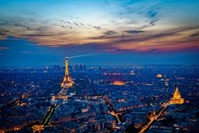 aerial view of paris with illuminated eiffel tower at sunset, france