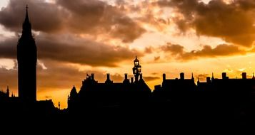 london landmarks silhouettes at golden evening sky, uk, england