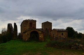 abandoned ruined building on hill at cloudy sky, italy, tuscany