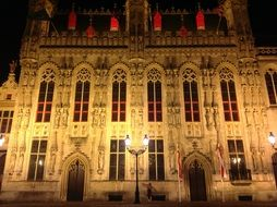 night view of medieval building facade, belgium