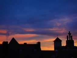 roofs of city houses at evening sky