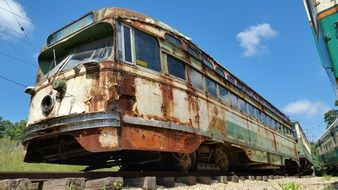 old rusted san francisco street car, retro tram on rails in countrycide