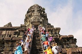 people on stairs of angkor wat temple, cambodia