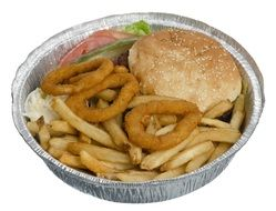 cheeseburger with french fries and onion rings in container