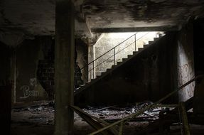 stairscase in interior of ruined abandoned building, france,
