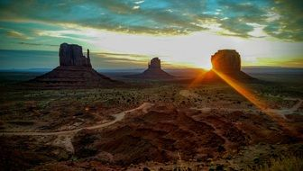colorful view of Mitten Buttes in monument valley at sunrise, usa, arizona