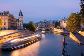 illuminated boats on seine river at night, france, paris