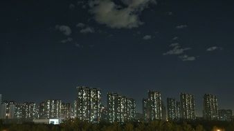 high rise residential buildings at night sky