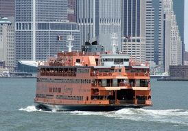 red ferry on water at staten island, usa, new york