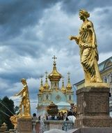golden statues at palace, russia, peterhoff