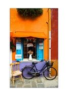 vintage black bike at colorful facade